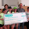 "VGroove Fitness ""Shake It For Sandy Hook"" Cardio dance fundraiser organizers Linda Lubinsky, back left, and Lee Shull, second from right, a $500 check for Sandy Hook Promise on Saturday, March 9, in the gymnasium at Edmond Town Hall. (Hallabeck photo)"