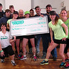 "VGroove Fitness ""Shake It For Sandy Hook"" Cardio dance fundraiser organizers presented members of Sandy Hook Volunteer Fire & Rescue and Newtown Hook & Ladder Co. #1 a $2,000 check on Saturday, March 9, in the gymnasium at Edmond Town Hall. (Hallabeck photo)"