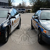 "As the Newtown Police Department and law enforcement agencies across the nation phase out the popular but discontinued Ford Crown Victoria, residents will see new black and white Chevrolet cruisers and next generation Ford Interceptor SUVs hitting the streets in town. Newtown Sergeant Aaron Bahamonde positions one of the remaining solid color ""Crown Vics"" beside a new black and white Chevy cruiser. (Voket photo)"