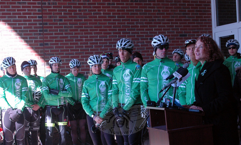 Congresswoman Elizabeth Esty, right, speaks at a rally held at Reed Intermediate School on Saturday, March 9, to send off Team 26 on a 400 mile cycling journey to Washington, D.C. (Hal-labeck photo)