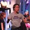 DSC_3930: Taylor Varga as J. Pierrepont Finch performs during a rehearsal for the Newtown High School upcoming production of How To Succeed In Business Without Really Trying was held on Friday, March 15. (Hallabeck photo)
