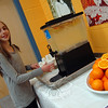 Reed Intermediate School sixth grader Oliva Brosnan samples orange-infused water provided at a beverage tasting state by Chartwells on Tuesday, March 19. (Hallabeck photo)