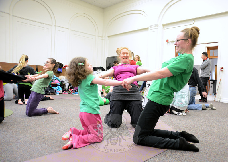 Jess Pinkney, right, and her daughter Rita enjoy an afternoon of CircusYoga at Hawley School with instructor Erin Maile O'Keefe, center. (Bobowick photo)