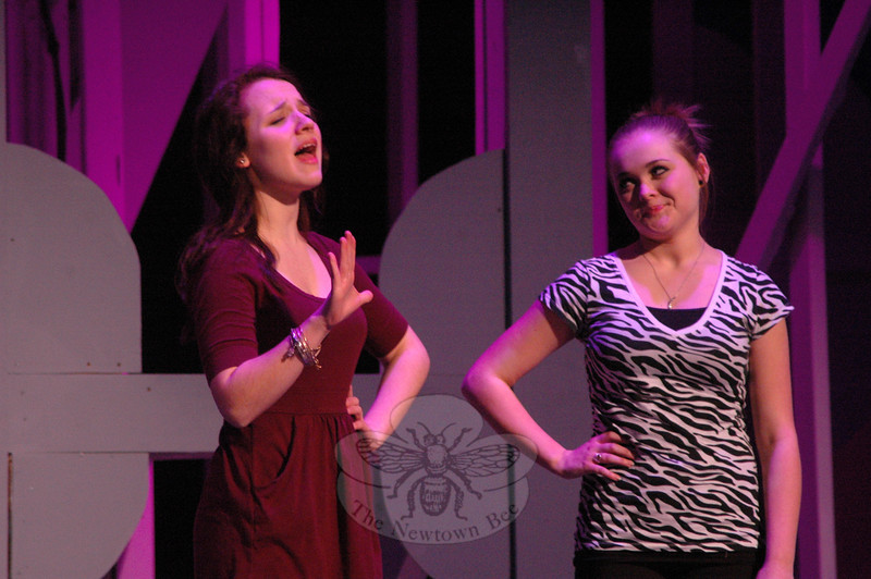Emily Anderson, left, who portrays Rosemary, and Brianna Bauch as Smitty perform during a rehearsal for the Newtown High School upcoming production of How To Succeed In Business Without Really Trying was held on Friday, March 15. (Hallabeck photo)