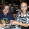 Lucy Henderson, left, and Maddie Ceci dissect a squid. (Hutchison photo)