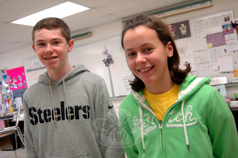 Newtown Middle School seventh grade students Henry Petrillo, left, and Julia Doyle are moving onto the state level of the History Day contest. (Hallabeck photo)