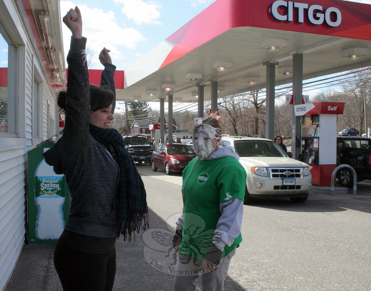 "Customers of Friendly Citgo on South Main Street had a once-a-year opportunity today on March 14: The chance to throw a pie into store manager Carol Lafreniere's face. Ms Lafreniere organized another fundraiser for the Muscular Dystrophy Association (MDA), where whipped cream pies were waiting for customers who made a $5 donation to MDA. Carol and crew — including Theresa Roberto, on the left — raised $270 this year, and took ""about 25 pies to the face,"" she said. Customers were also able to purchase paper shamrocks for MDA, and this year they were also able to enjoy cupcakes provided by Cherries Cupcakes, a new cupcake shop located across the street from the convenience store and gas station. While the one-day event is long finished, customers can always donate to MDA during the year thanks to collection boxes on the counter inside the store. The Newtown store raised a total of $1,016 through the additional paper shamrock sales and donations during the past 12 months, which was part of the more than $20,000 raised through all Consumers Petroleum stores, according to Ms Lafreniere. (Hicks photo)"