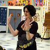 "Dance Caller Patricia Campbell directed families and friends who turned out early March 22 to do-see-do along with live music from The Reel Thing & Friends at HealingNewtown Arts Space. Billed as an evening of community dancing, sea chanteys and chorus songs, the free gathering — ""All Hands In: A Celebration of Community through Traditional Song and Dance"" — also accepted donations for the Newtown Lions Club Foundation Fund to benefit responders as well as the children, families and staff of Sandy Hook School. The event also featured Tod Whittemore and members of The Johnson Girls, along with other guest artists sitting in. Members of The Reel Thing include Fran Hendrickson on piano, Bill Campbell on bass, Sue Hill on fiddle, and guests Guy Wolff on banjo with Dee Wheeler on guitar.         (Voket photo)"