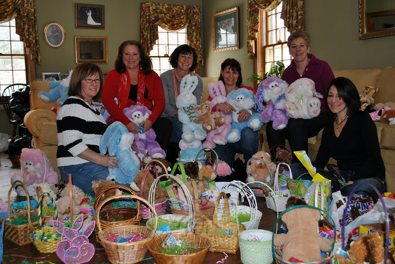 It was the first time in 16 years of putting together Easter baskets for charity that Women Involved in Newtown (WIN) has done so with snow on the ground, said member Mandy Monaco, but that did not stop members from creating and delivering 180 Easter baskets, over a five-hour period, Thursday, March 21. Thanks to the generosity of WIN members, friends, and neighbors who donated baskets, Easter grass, and candy, and donations of stuffed toys from Monsignor Robert Weiss of St Rose of Lima and the Town of Newtown, the baskets were delivered to the AIDS Interfaith Ministry, Harmony House, and Healing Hearts, all of Danbury, and to Newtown Social Services for distribution. Pictured above assembling baskets are WIN members, from left, Kim O'Rourke, Donna Giles, Sue Rubino, Mandy Monaco, Alice Baye, and Lisa Burbank. (Crevier photo)
