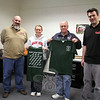 Sandy Hook Fire & Rescue EMS Captain Karin Halstead and her father, Chief Bill Halstead, show off the green and white T-shirts that have been sold since shortly after 12/14 to benefit The Sandy Hook Family Healing Fund. The fire company worked with Alex Rankin, on the left, and Charlie Rankin, on the right, to design the shirts, which are being sold through Rankin Sporting Goods. (Hicks photo)
