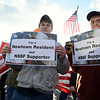 Two National Sport Shooting Foundation supporters carry signs also declaring that they are Newtown residents. (Bobowick photo)