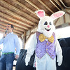 The Easter Bunny was the center of attention Saturday, March 30, as parents and children stepped up to meet him. At left is GCF Youth Pastor Adam Fredericks, (Bobowick photo)
