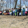 Waiting behind the line at the top of a hill, children soon burst through, ready to rush into a field and fill their bags and baskets with eggs. (Bobowick photo)