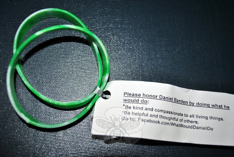 The family of Daniel Barden feels that in addition to addressing gun violence prevention, family and community connections are vital, as is a change in cultural attitudes. In memory of their son, Jackie and Mark Barden have sanctioned a family Facebook site, WWDD:WhatWouldDanielDo, to promote random acts of kindness. Pairs of bracelets encourage recipients to spread kindness. (Crevier photo)