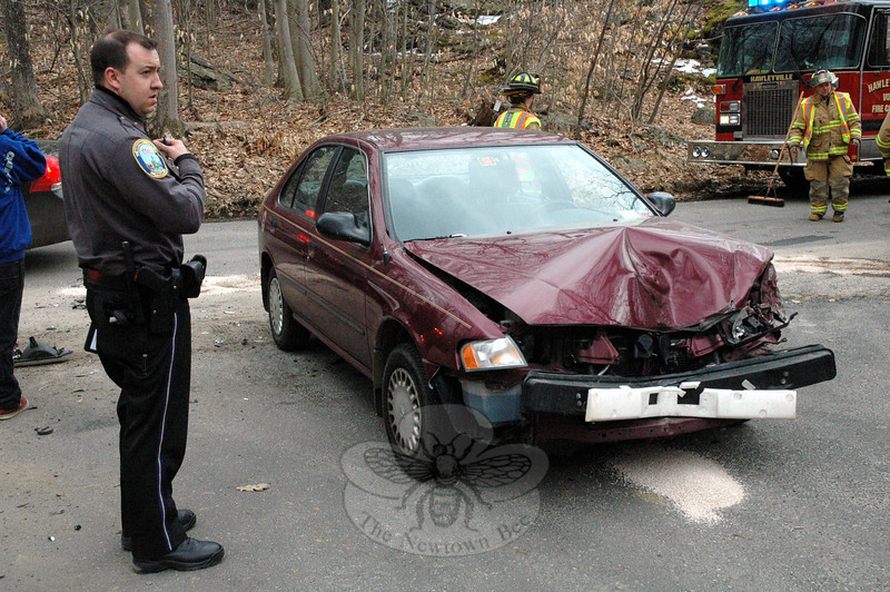 Police report a two-vehicle accident near 59 Butterfield Road, on the section of that street between its intersections with Hanover Road and Parmalee Hill Road, at about 3:44 pm on March 25. The side-swipe accident occurred on a curve on the narrow, winding road. Police said that the drivers involved in the crash were eastbound motorist Harrison Snellback, 18, of 201 Sugar Street, who was driving a 1997 Nissan Sentra sedan, and westbound motorist Thomas Mead, 42, of Southbury, who was driving a 1997 Ford pickup truck. Newtown Volunteer Ambulance Corps members responded to the scene to check Mead for pain, police said. Hawleyville volunteer firefighters responded to the collision. Police report that they issued Snellback an infraction for failure to drive to the right. (Gorosko photo)