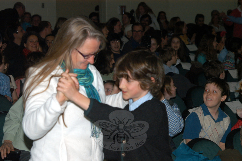 Jo Hurly waltzes with her son, Sean Christiansen during the Housatonic Valley Waldorf School Language Assembly at Newtown Middle School on March 23. (Hutchison photo)
