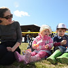 Anna Suriano, 18 months, and her brother Stephen, 3, sit with their mother Holly and grandmother Carrie Polmateer. Ms Polmateer had traveled from Albany, N.Y., for the event. (Bobowick photo)