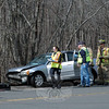 Newtown Hook & Ladder and ambulance corps volunteers responded midday on Monday, April 1, to a one-vehicle accident on South Main Street. Police report that motorist Linda Decker, 58, of 7 Old Town Road was driving a 2001 Honda Civic sedan southward on South Main Street, near its intersection with Park Lane, about 12:24 pm, when the Honda went off the right road shoulder and then struck a guard post and a utility pole. Decker was transported to Danbury Hospital for minor injuries, police said. The accident is under investigation. (Gorosko photo)