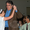 Neil Abramson waltzes with his daughter Isabelle during the Housatonic Valley Waldorf School Language Assembly at Newtown Middle School on March 23. (Hutchison photo)