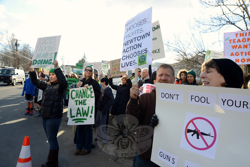 A host of signs carry different appeals, which protesters waved at passing traffic Thursday, March 28. (Bobowick photo)