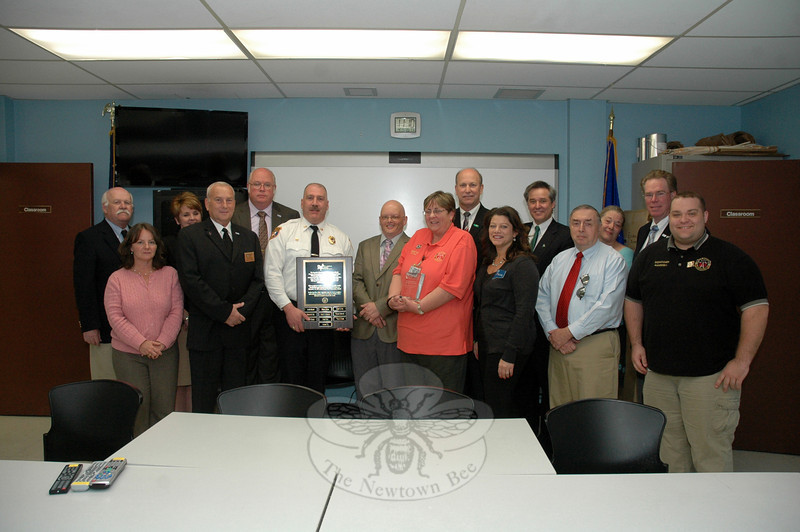 The Association of Public-Safety Communications Officials (APCO) presented an award to the staff of the Newtown Emergency Communications Center at Town Hall South on April 17. The award recog-nizes the communications center's expert handling of radio telecommunications traffic stemming from the December 14 shooting incident at Sandy Hook School. (Gorosko photo)