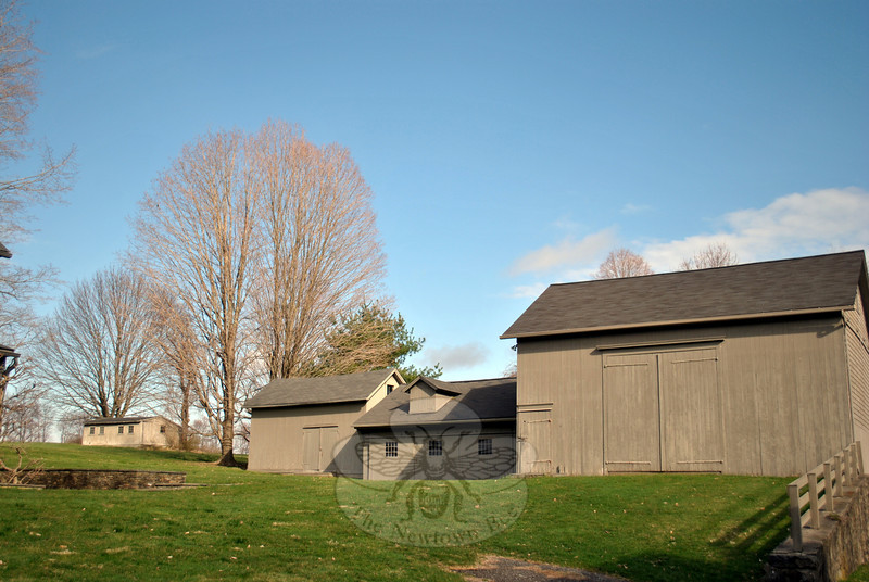 Very few exterior changes have been made to any of the three main barns on the Blackman Farm-stead, which now serve as art studios for Robert Cottingham. The freestanding building to the far left is an original chicken coop, from the days when the farm was a working dairy farm. (Crevier photo)