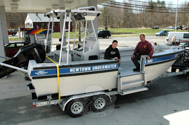 Newtown Underwater Search And Rescue (NUSAR) has acquired a custom-made 20-foot-long alumi-num dive boat for its work on local and area waters. The vessel replaces a 19-foot fiberglass boat that the volunteer organization formerly used. Shown with the new boat are NUSAR President Nick Kopcik, right, and his son Stephen. (Gorosko photo)