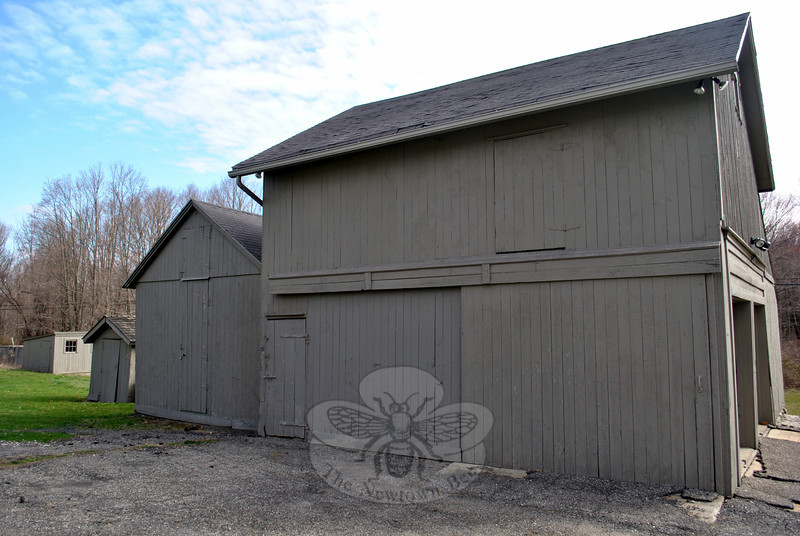 The largest of these three outbuildings on Blackman Farmstead is currently used as a garage, but once served as a stable and hayloft. To its immediate left is the goat barn. The two smaller buildings were probably borning sheds. (Crevier photo)