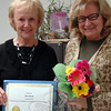First Selectman Pat Llodra, left, surprised Director of Social Services Ann Piccini on Friday, April 12, with flowers and a commendation for 25 years of service to the Town of Newtown. Mrs Llodra noted Ms Paccini's dedication, and thanked her for all her efforts over the last 25 years. Friday marked 25 years to the date that Ms Piccini began working with the Newtown Department of Social Services. (Hallabeck photo)