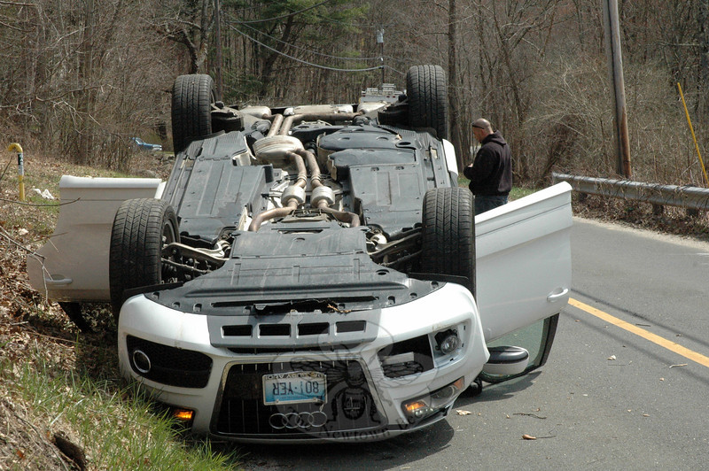 This 2011 Audi Q-5 SUV flipped over and landed on its roof in an accident that occurred about 1:25 pm on April 15 on Hanover Road, north of its intersection with Echo Valley Road. Police said motorist Edna Frey, 58, of 2 Echo Valley Road was driving the Audi northward on Hanover Road, when the ve-hicle went off the street and then struck a tree, resulting in it rolling over and landing on its roof. The Newtown Volunteer Ambulance Corps transported Frey to Danbury Hospital to be treated for injuries, police said. Hook & Ladder volunteer firefighters responded to the accident. The accident is under in-vestigation. (Gorosko photo)