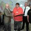 The Association of Public-Safety Communications Officials (APCO) presented an award to the staff of the Newtown Emergency Communications Center at Town Hall South on April 17. The award recog-nizes the communications center's expert handling of radio telecommunications traffic stemming from the December 14 shooting incident at Sandy Hook School. Pictured, from left, are Dispatcher Jason Chickos, APCO Atlantic Chapter President Craig Scholl, Newtown Director of Emergency Communica-tions Maureen Will,  APCO Atlantic Chapter Past President Frank Kiernan, and Dispatcher Tom Ramsdell. (Gorosko photo)