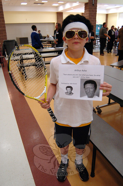 "Arthur Ashe was portrayed by sixth grader Jake Kneski for his cluster's ""One Person Can Make a Dif-ference"" project presentation. (Hallabeck photo)"