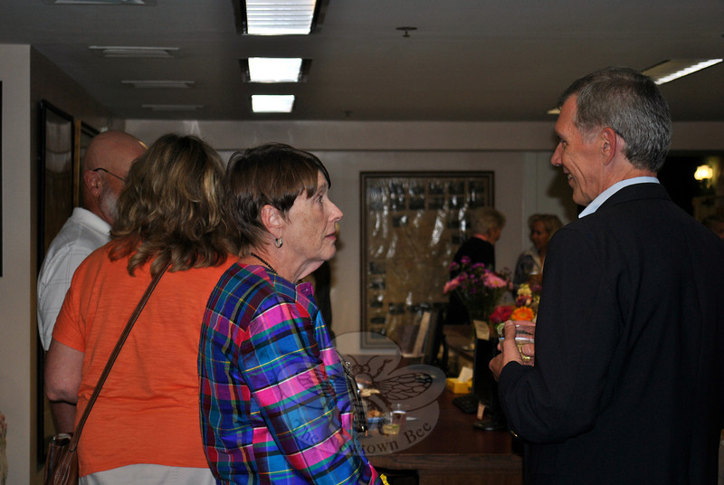 Janet Woycik and State Librarian Ken Wiggins exchange a few words at the June 26 farewell reception for Ms Woycik. (Crevier photo)