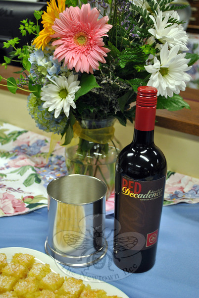 An inscribed pewter chiller and a bottle of chocolate wine were parting gifts from the library staff to Janet Woycik. (Crevier photo)