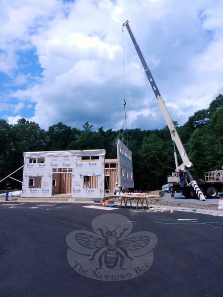 The final side of the new Barn Yard office building is put in place on Friday, June 28. The Barn Yard & Great Country Garages, presently located at 857 Federal Road, Brookfield, is on the move and will have a soft opening on an August date, to be announced, in Bethel, between the Newtown town line and the four corners in Stony Hill. According to Everett Skinner, Sr, owner of the company with his two sons, Everett Jr and Chris, the new location will have enough space to show a great many buildings, including a two-car garage, which is one of the permanent fixtures on the seven-acre parcel. (R. Scudder Smith photo)
