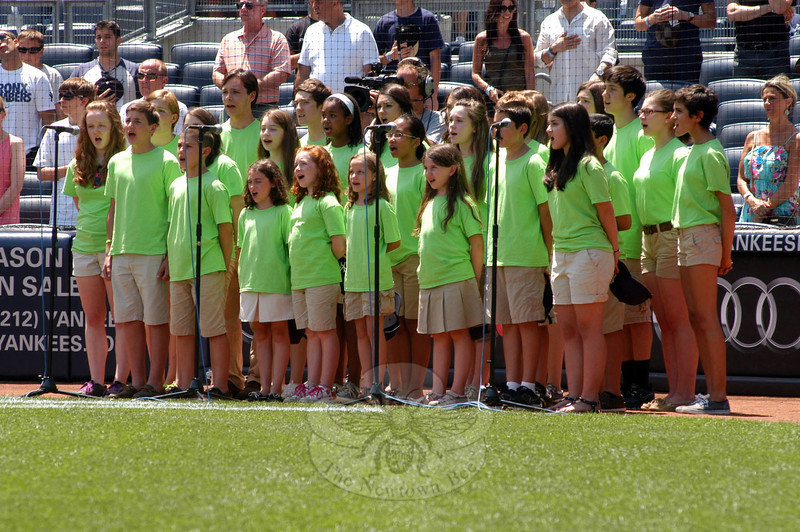 Newtown singers perform the national anthem at Newtown Day at Yankee Stadium, held on Sunday, June 30. (Hutchison photo)