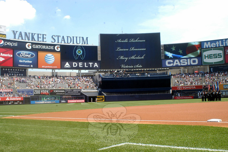 Names of those lost in the Sandy Hook shootings scroll on the video board during a pregame ceremony for Newtown Day at Yankee Stadium, held on Sunday, June 30.(Hutchison photo)