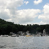 Both on the water and along its shores, residents kept cool in Lake Zoar on Thursday, July 4, as temperatures pushed toward 90 degrees on Independence Day. Boaters often gather along a shallow sandbar at a bend in the river near Underhill Road. Beyond the boats are waterfront homes in Sandy Hook. (Bobowick photo)