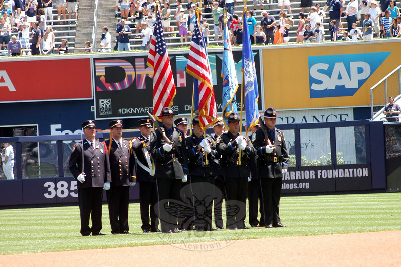 Newtown Color Guard members, including Newtown police and firefighters, participate in Newtown Day festivities on the Yankee Stadium field on Sunday, June 30. (Hutchison photo)