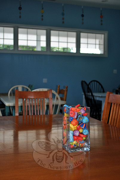 Glazed beads fill a glass vase on one of the five tables in the workroom at the new Ben's Bells Newtown studio at 17 Church Hill Road. (Crevier photos)