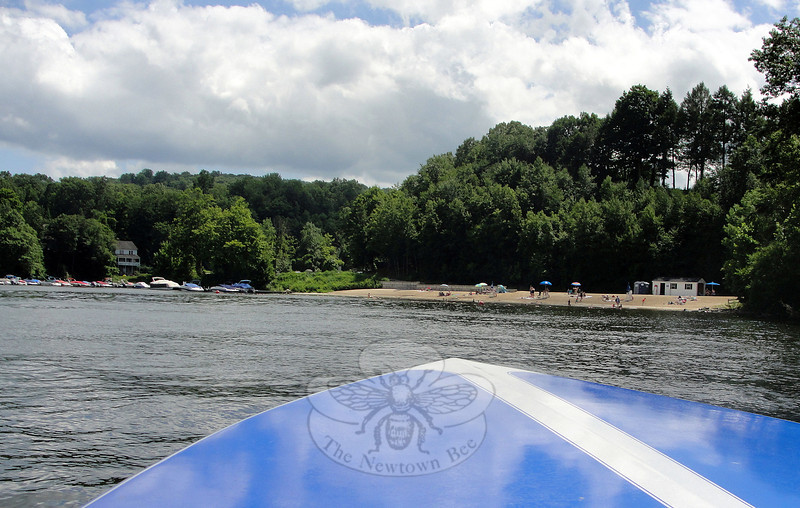 Eichler's Cove Marina off Old Bridge Road in Sandy Hook saw many boat owners motoring out onto Lake Zoar from the marina and boat launch, left. Other residents spent the July 4 holiday on the sandy beach, visible over the nose of a boat, right. (Bobowick photo)