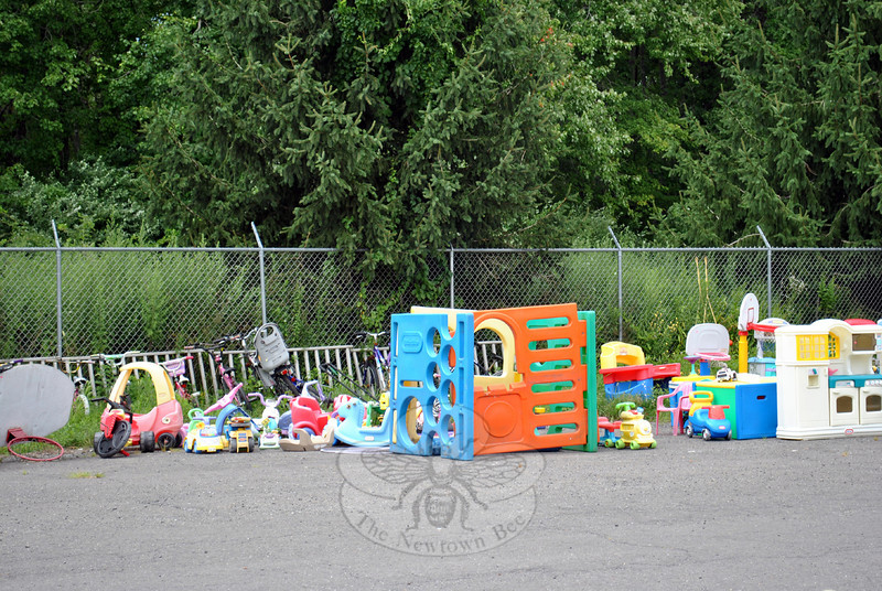 A large selection of children's large item toys and bicycles are neatly lined up outside of Make A Home Foundation. The foundation's intent is to provide free household, furniture, and other items to homeless veterans, individuals, and families trying to recreate homes, at no cost. Without sales to the public, Ms Pettengill and Mr Telesco say they cannot cover the high cost of warehousing the many donations they have received.  (Crevier photo)