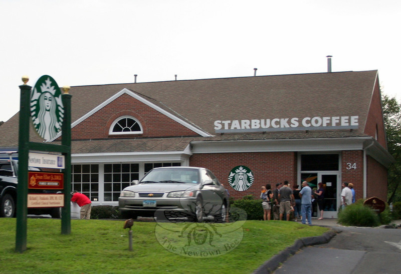 Newtown's Starbucks location was closed by 5:45 Friday evening, diffusing tensions that had been building during the day between pro-gun and gun control advocates. Many people at the Newtown store were caught off guard by the early closing. (Hicks photo)