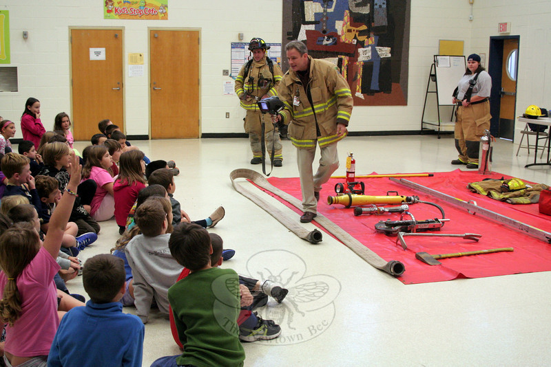 Firefighters from Sandy Hook Volunteer Fire & Rescue spent Friday, October 12, at Sandy Hook School. Nearing the end of Fire Prevention Week, it was a time for students of all grades to learn about fire safety for themselves and their homes, as well as see some of the tools used by firefighters. Five members of the company arrived at the school for a fire drill Friday morning, and then spent the remainder of the day presenting programs geared to the different age levels. Students listened to presentations by Engineer Rob Sibley — seen here showing one group a thermal camera, while Firefighters Pete Barresi and Erica Knapp look on — and were then encouraged to ask questions. Each group was also given time to meet the firefighters and then headed outdoors for a few minutes to see (and, when the rain stopped, go through) Engine 442, one of Sandy Hook's pumpers. (Hicks photo)