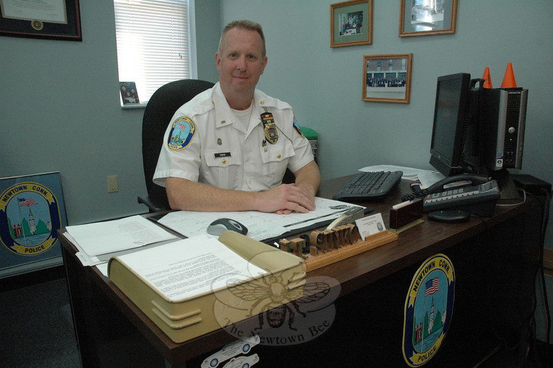 Lieutenant George Sinko, one of three lieutenants at the Newtown Police Department, recently returned from an intensive ten-week executive leadership training program at the FBI National Academy in Quantico, Va. Lt Sinko is pictured at his desk at the police department. (Gorosko photo)