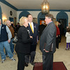 First Selectman Pat Llodra speaks briefly with Second District Republican incumbent Dan Carter, right, during an informal 30-minute meet and greet held prior to a candidates forum held at the Edmond Town Hall Tuesday evening. With them is 106th District contender and Republican Mitch Bolinsky. (Bobowick photo)