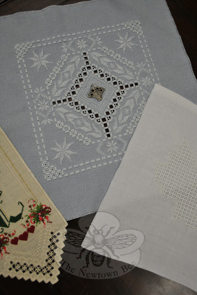 Two examples of Hardanger embroidery, in which threads are counted and cut to create an open design, and on right, one of pulled thread embroidery, are works by Friends of Counted Embroidery Co-president Lynn Harrison. The local group is currently seeking new members. (Crevier photo)