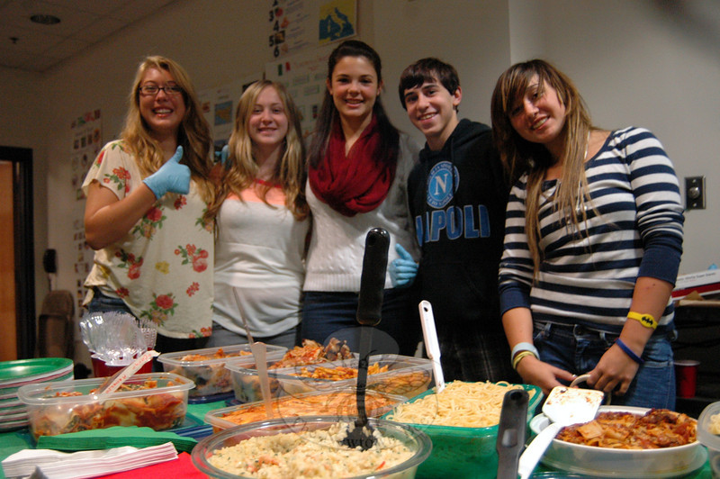 Students taking Italian at Newtown High School attended Italian Day, held in the school's Lecture Hall on Friday, October 12. Before the event, students studied various facets of Italy, including notable inventors, fashion, and food. Teacher Laura Battisti oversaw the day, and students also prepared food for the event to share with other students. NHS sophomores, from left, Samantha Kruzshak, Marisa Leone, Julia Bell, Michael Biancardi, and Amanda Vitti helped hand out food during the day. (Hallabeck photo)