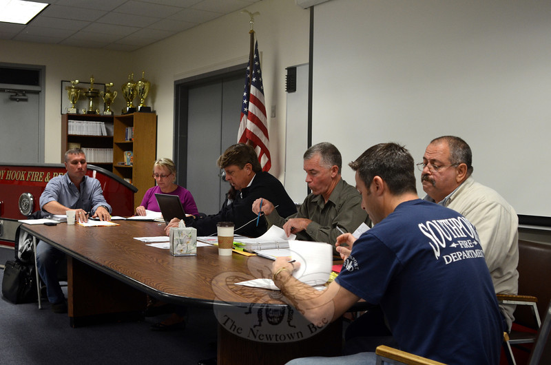The Board of Fire Commissioners, from left, Rob Manna, Elisa Goosman, Kevin Cragin, Michael Burton, Jay Nezvesky, and Ernie Descheneaux prepare to elect new leadership during a regular meeting October 15. After 21 years as the civilian chairman, Mr Cragin handed over leadership of the board to Mr Manna, who was elected to the post. (Voket photo)