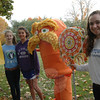 This year's entries for Newtown Middle School's My Favorite Scarecrow Contest went up on Saturday, October 20, and will remain on the front lawn of the Queen Street school until Sunday, October 28. From left, Sophia Albano, Alexa Horkachuck, and Kate Moyle stand with their entry in this year's contest, a life-size representation of The Lorax, a Dr Seuss character from a book and movie by the same name. Voting in the contest will be open until Sunday. For further details about the contest see the story on page B7 in this week's Newtown Bee. (Hallabeck photo)